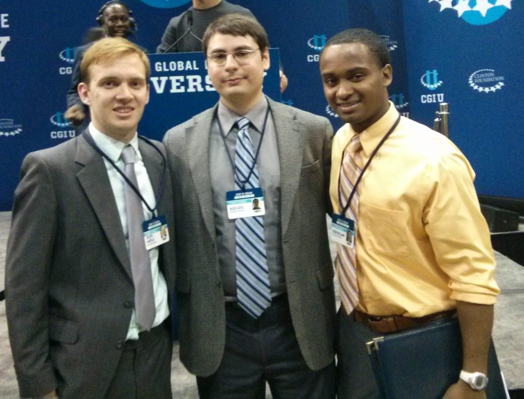 (From left to right) Joe Lanzilla and Alex Luta of SATCOHR, and Febin Bellamy (GU's CGI U Campus Coordinator), represent Georgetown at the conference.